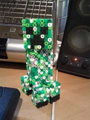 Instructions to make your own Minecraft creeper out of Perler beads.