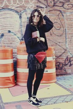Leandra with her two bags... one of which is a bum bag/fanny pack (depending on which country you are in!) from Larissa Hadjio. The clutch is Edie Parker. And that cool ass leather fringing skirt is from Zara, American Apparel jumper & Ralph Lauren shades. go girl. #LeandraMedine #ManRepeller