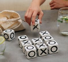 Ceramic noughts and crosses in a glazed ceramic. Set comes complete with its own draw-string calico storage pouch. Not suitable for children under 3. SIZE: Each cube is 4cm x 4cm