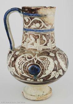 Jug  12th-13th century  Northern Syria  Fritware, lustre-painted overglaze decoration, transparent glaze, colour highlights