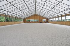 Indoor arena with great natural light, thanks to the fabric roof. The overall look is a bit busy.