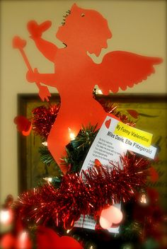 Who says you have to put the Christmas Tree away after Christmas? Re-decorate it into a #Valentine's Tree!