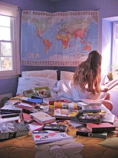 Pinning this just because of a bed full of books and a world map. This looks like a great room