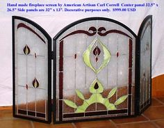 """Stained Glass Fireplace Screen Centre panel is 32"""" high and 26.5"""" wide. Each side panel is 32"""" high and 13"""" wide. This fireplace screen is not heat tempered and may crack if placed too close to a hot fire."""