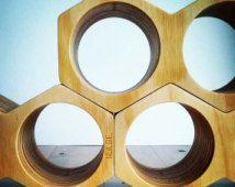 Wine Holder, Geometric, Honeycomb Design, Timber, Warm Golden Tones, Modular Wine Rack, Layered, Sculptural, Tactile Finish