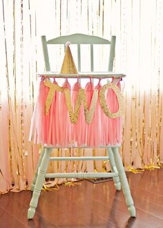 Decorated high chair at a pink and gold girl birthday party!  See more party ideas at CatchMyParty.com!