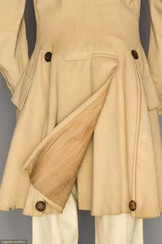"""MAN'S SUPER-FINE WOOL COAT/SURTOUT, AMERICAN, 1820s .  Beige wool broadcloth, fitted through chest, tan velvet collar & turn back cuffs, diagonal double row of brown thread buttons, side & F waist seam, double pleats to wide back skirt, CH 40"""", L 39"""", Note the odd bottom buttons and what seam to be extra pleats holding over from the Justaucorps days."""