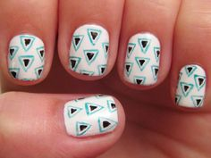 Tiny Triangles - Start with a white base. Paint small black triangles, and carefully outline them in a bright color. Alice from One Nail to Rule Them All used teal, but we think red or yellow would look great, too. Nail Art Inspiration - Manicure Design Ideas - Good Housekeeping