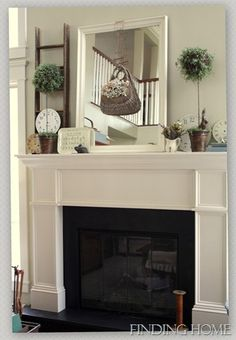 Spring Mantel - a basket filled with spring flowers is highlighted by hanging it on a large mirror and displayed on the mantel - via Finding Home