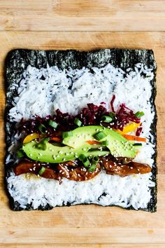 You may never go back to traditional sushi after one bite of this Vegan Teriyaki Sushi Burrito Its perfect for taking onthego Satisfying delicious Sushi Recipes, Vegetarian Recipes, Healthy Recipes, Drink Recipes, Dinner Recipes, Vegan Foods, Vegan Dishes, Sushi Burrito, Homemade Sushi