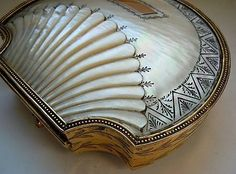"""collectorsweekly: """" Carved shell and engraved gilt sewing kit lined with blue silk, made in Paris, c. 1815-1820. """""""