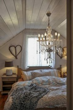 Rustic bedroom, chandelier, cozy, bed under window