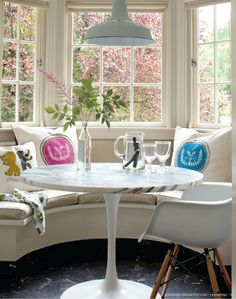 Great circular breakfast nook.  The natural light is wonderful. love the table and pillows.