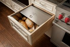 Bread drawer!  keeps it off the counter!  I would really like a bread drawer if there is space.