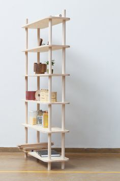 TS1 is a modular shelving system put together relying on threaded wooden rods. The shelves in between are held firmly using the mechanism of a bolted joint.