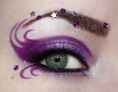 """""""Purple Fantasy"""" eye make-up with stars and crystals by Madam Noire."""
