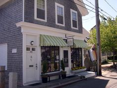I own a little shop on main street. I have been trying to think of ways that I can decorate it from the outside and make it look more appealing. I saw this picture and thought an awning would be perfect. I really like the striped two color awnings and that is what I would want to get to my shop.