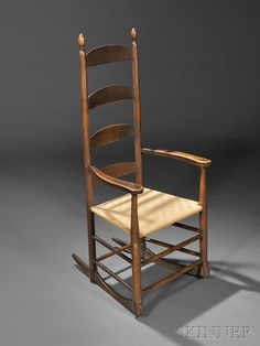 The Andrews Shaker Collection | Sale 2731M | Skinner Auctioneers Shaker Brown-Red-painted Rocking Chair, New Lebanon, New York, c. 1800 (Estimate $12,000-$15,000)