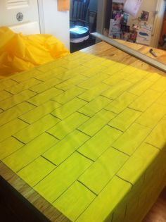 In preparation of our Wizard of Oz birthday party this week, we have drawn bricks on 100 feet of plastic, yellow tablecloth. I love the way it turned out.