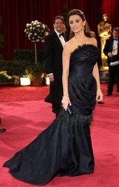 Pin for Later: 85 Unforgettable Looks From the Oscars Red Carpet Penelope Cruz at the 2008 Academy Awards Penelope Cruz opted for this black feathered Chanel gown in 2008.