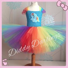 Rainbow Dash Tutu Dress.  Beautiful & lovingly handmade.  All characters and colours available Price varies on size, starting from £25.  Please message us for more info.  Find us on Facebook www.facebook.com/DiddyDarlings1 or our website www.diddydarlings.co.uk