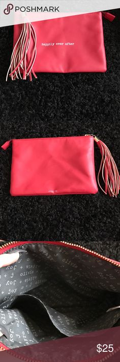 "Happily ever after pouch with tassel ""olivia + joy"" of NY ""happily ever after"" clutch. Zippered top closure, leather like material. Hardly ever used Olivia + Joy Bags Clutches & Wristlets"