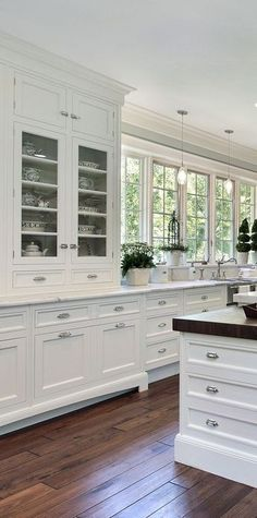 White kitchen design ideas. Love the cabinet for dishes, and that the cabinetry is ceiling height.
