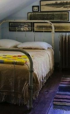 this looks just like our beds upstairs and I love the old photos on the wall!  ~Lisa~