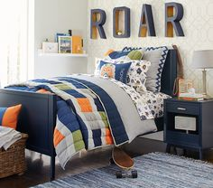 Blue, orange, and mid-century design take the little kid's room to big kid's room.
