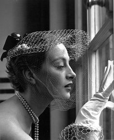 Capucine wearing a hat by Jean Barthet. Photo: Georges Dambier.