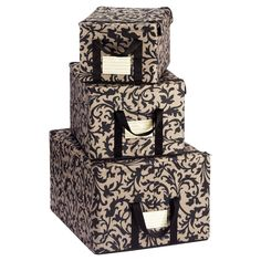 "Baroque Taupe Fabric Storage Boxes.  Made from rugged polyester fabric over a metal frame. Sturdy handles for easy transport. Includes label holder for easy identification of the contents. Folds flat when not in use for compact storage. 14-3/4"" x 10-1/4"" x 8-1/4"" h @ $14.99, 16-1/4"" x 12-3/4"" x 9-1/2"" h @ $17.99, 20-1/4"" x 16-1/4"" x 11-1/2"" h @ $21.99."