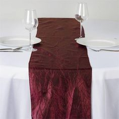 Burgundy Taffeta Crinkle Table Runner | Let this exquisite runner enchant the entire ambiance of your special event with its seamless luster and upscale look. Blending the modern flair with traditional sophistication, this magnum opus is simply magnificent. Spread it atop your dreary tables or plain, lackluster table covers to achieve the excellence of class and vibrancy. The lovely crinkles accented all over the surface coupled with the impeccable metallic glint of lustrous taffeta will…