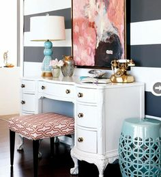 {Everything about this vanity / writing desk is perfection...down to the striped wall and gold phone}