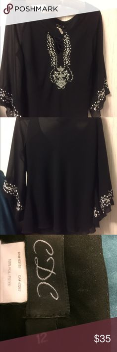 """CDC BLACK TOP White Embroidery & Bell Sleeves-HP!! Black Top Beautiful 🎉HOST PICK🎉 Front Tie & Rich White Embroidered Detail, Lined. Lovely & Trending Style!🖤Length: Front 19"""", Back 21"""", Sleeves 18"""". Quality Made! Would fit Med - XL, Excellent Used Condition 🎉POSH HP 🎉 Smoke-Free Fashion Loving Posher!😍 CDC Tops Blouses"""