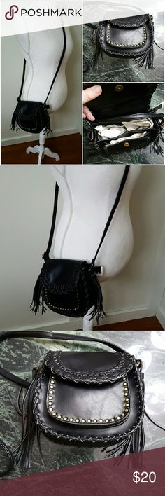 DV Small Black Faux Leather Crossbody Bag DV small black faux leather bag with tassels on each side. Small pocket in the front. Big enough for a cell phone. DV Bags Crossbody Bags