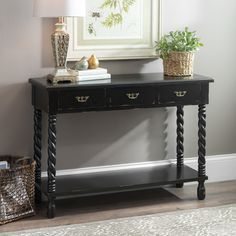 Take a different approach to home decor and find special items like the 'Black Tiffany Twist' console table. It's twisted leg accents and antique charm add that little something extra guests will love around the holidays.