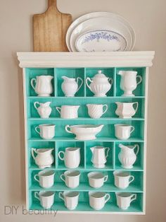 This cabinet formerly housed ribbon and craft supplies! I painted it a tiffany blue and repurposed it to showcase my collected Ironstone! DIY beautify - Home Decorating Diy Ideas Upcycled Furniture, Painted Furniture, Diy Furniture, Display Shelves, Shelving, Pyrex Display, China Display, Tea Cup Display, Blue Shelves