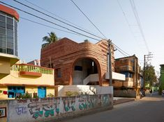 Informed by terracotta temples found in West Bengal, this two-storey community centre is designed to provide a variety of flexible spaces for the local community in Bansberia along with a dormitory for staff. Brick Masonry, Masonry Wall, Open Stairs, Building A Garage, Studio Build, Local Festivals, Indian Architecture, Architectural Photographers, Hindu Temple