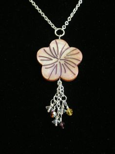 Hibiscus Flower  Shell pendant with Swarovski by ThatGirlsDesigns, $13.00