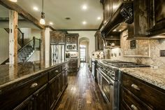 Traditional Kitchen with Custom hood, Raised panel, Flush, L-shaped, Wolfe - 6 burner + griddle, double oven, Crown molding