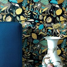 Update your bedroom decor with this romantic Wallpaper Design. A dark and moody style with pops of stunning color that are truly striking against the crisp dark background. Interior Wallpaper, Wallpaper Ideas, Amy Howard, Indoor String Lights, Works With Alexa, Hanging Ornaments, Dark Backgrounds, Designer Wallpaper, Home Crafts