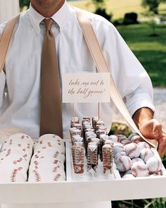 Ballpark Vendor Wedding Favors  After dinner, as a surprise for the groom who is a baseball fan, this bride had waiters walk around with trays like ballpark vendors, giving out chocolate baseballs, iced sugar cookies, and old-fashioned candies. #mesadedoces #shopfesta
