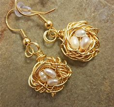 Shiny gold nest with delicate pinkish freshwater pearl earrings.