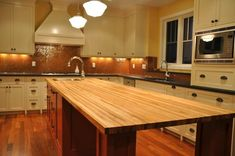 Maple butcher block . Look at this work/ counter space! I love the layout with the sink on the island.