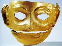 Gold Mask, late Shang-Early Zhou Dynasty.  The face and cheeks of the mask are round, with extending ears. The curves of the ears are hammered out. Each of the lobules has a concave part shaped like a hole, but not through. The crescent-like brows are a bit protruding. The bridge of the nose is high. And the eyes and the big mouth are hollowed-out, with the mouth slightly opening, as if smiling. The mysterious-looking mask was unearthed from the Jinsha ruins in Chengdu.