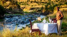 Every so often we like to really push the boat out...a candle-lit private dinner by the river usually does the trick! ‪ (Sand River Masai Mara)