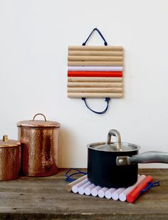 DIY Leather and Wood Trivets via Wantist. A little colorful, crafty touch for the kitchen.