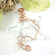 Ive fused together clear glass to create this fused glass suncatcher ornament. One the star is fully fused I hand wrap it with copper wire. Each