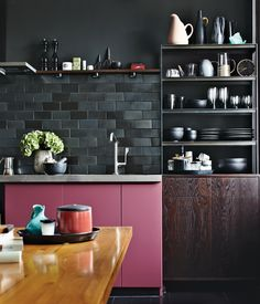 Love the color & texture of  the black tile back-splash, yuck pink cupboard tho