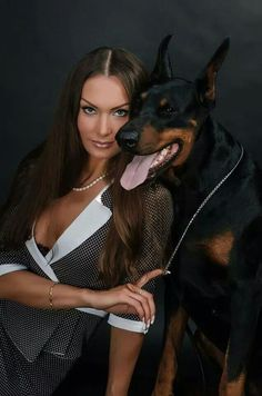Doberman with a model